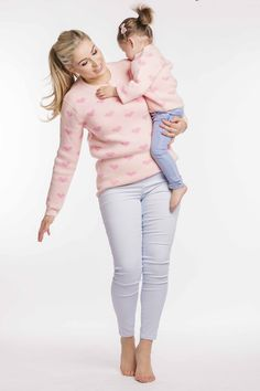 MOTHER AND DAUGHTER MATCHING JUMPER One of our favs! This is the perfect jumper to bid welcome to warmer weather while blocking the breezes spring brings with it. Matching Clothes, Matching Outfits, Baby Jumpers, Heart For Kids, Mother And Child, Bright Pink, White Jeans, Capri Pants, Bring It On