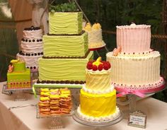 Wedding Cakes: Wedding cake buffet variety with yellow and green and pink frosti