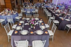 Wedding Reception | Purple Linens | Silver Chargers | Silver Chiavari Chairs | Pewter Vases | Shades of Purple Flowers  Photo Credit - Heather Brulez Photography