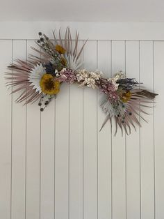 The perfect DIY flower arrangement/wall decor for a girls bedroom.  Attach dried flowers to a stick.