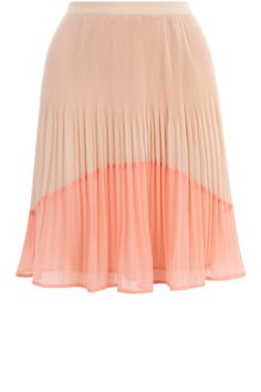 As seen in InStyle and LOOK magazine. This knee length skirt is a pleated style with complementing colourblock detailing.