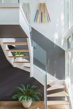 You'll Covet This Color-Soaked Brooklyn Apartment  #refinery29  http://www.refinery29.com/dwell/1#slide-5  The back staircase abuts a glass facade overlooking the backyard and allowing plenty of light into the kitchen area above. The art hanging on the wall is by artist Julie Thevenot. ...