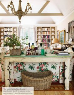 Nicky Haslam, rustic style, reclaimed furniture, sofa table, living room styling, bookcases, styled built-ins, wooden beams, granny chic