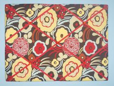 Chic french memo board featuring red & yellow flowers, grosgrain ribbon, & red rhinestones; by two dot designs