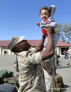 Cpl. Jason Singleton hoists his son, Cameron, in the air as he prepares to leave Camp Pendleton, Calif., for a six-month deployment to Australia. Cameron was born just before Singleton returned from his last deployment and turned 1 year old in 2014. (PHOTO BY JENNIFER HLAD/STARS AND STRIPES)