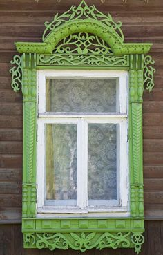 Russian wooden house from the city of Kostroma. A window is decorated with openwork carving.