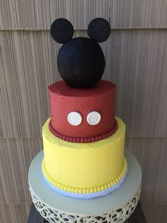 Mickey Mouse second birthday tiered cake. Salted caramel with black cocoa buttercream, vanilla with vanilla buttercream and chocolate with vanilla buttercream complete with ears and buttons