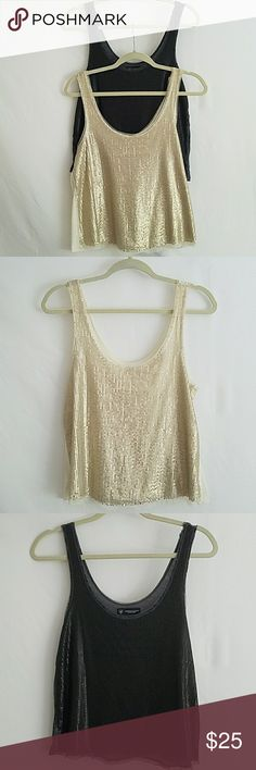 Beautiful 2PC Bundle AE Tank Tops American Eagle (1 dark gray & 1 ivory/gold) Sequin Flowy Tanks. Not your grandmother's disco sequence. This is a muted sequence that can be worn in the day and pairs great with a denim skirt. Beautiful lace details. Machine washable. American Eagle Outfitters Tops Tank Tops