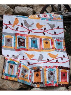 "Featuring birdhouses and their occupants perched nearby, this sweet pattern will make a lovely throw to show off all spring. Finished size is 60"" x 75""."