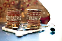 Bangles or choodiyan adore the wrist of the bride and are usally made of glass, laakh or gold. Conventionally, brides adore their wrist with red bangles.