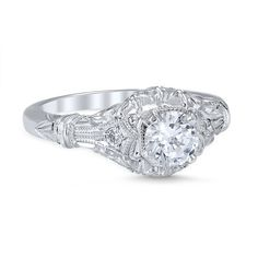 Vintage Style Edwardian Blossom Die Struck .56cttw Diamond Engagement Ring. 14k white gold vintage style Edwardian Blossom antique style engagement ring featuring a delicate bouquet of filigree flower