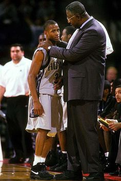 Allen Iverson and John Thompson 1995 The young guard was a phenom during his two years with the Hoyas: earning the Big East Rookie of the Year honors, claiming two Big East Defensive Player of the Year awards and averaging a school-record points per game. Basketball Trainer, Sport Basketball, Basketball Pictures, Love And Basketball, Basketball Legends, Sport Football, Sports Pictures, College Basketball, Basketball Players