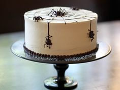 Spider Cake -- Spiders on a cake are just plain creepy and a whole lot of fun. The marble cake will satisfy your cravings for both vanilla and chocolate. Nutella buttercream and bittersweet ganache spiders are the perfect finishing touches.