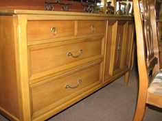 Pecan-wood server with 3-drawers and 1-door, lots of storage, and straight lines $200. Available in-store
