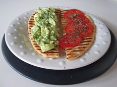 Avocado egg salad with tomato on naan bread