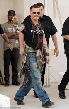 Johnny Depp plays guitar and sings back-up for the band Hollywood Vampires. Looking good Johnny <3
