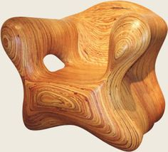 Chair - Craved with a chainsaw. The shape and the wood grain is gorgeous. I just want to touch this. It looks soooo smooth. Love it.