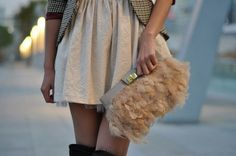 Love the contrast of the tailored jacket with the feathers on the bag. Love it!