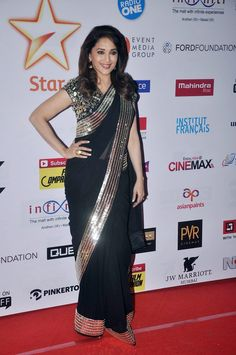 Madhuri Dixit in a black saree with silver border at MAMI 2014 closing ceremony. #Bollywood #Fashion #Style #Beauty