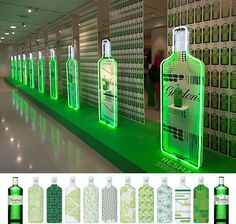 GORDON'S GIN TEN GREEN BOTTLES- 09.19.12--- Artful display created from your product! Reminds us to raise the bar on merchandising display!!!