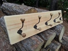 Made from locally milled cypress, this coat rack will add charm anyplace it hangs. The cypress wood is selected by hand for character and then lightly sanded to smooth the edges.  The cypress is left natural enabling its native color and texture to be seen. It includes five decorative metal hooks with carved knobs mounted with antique brass screws.  Perfect for an entryway, mud room, or foyer.