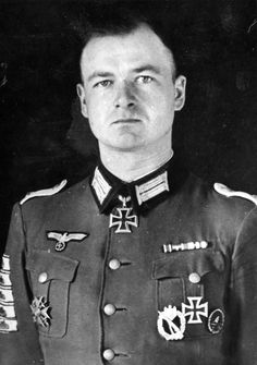 Oberleutnant Peter Kiesgen won the Knights Cross on 5 Oct 1941 during Operation Barbarossa as Führer of 1./Infanterie-Regiment 239 of the 106. Infanterie-Division. He wears five tank destruction badge on his right sleeve, each one awarded for the single-handed destruction of an enemy tank. Other medals include the Infantry Assault Badge, Iron Cross First and Second Class, Wounded Badge in Black and interesting on his right center of the pocket the Spanish Cross in Bronze with Swords.