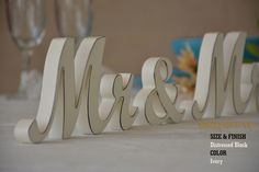 A personal favourite from my Etsy shop https://www.etsy.com/listing/270066964/rustic-mr-mrs-wedding-sign-with-dark