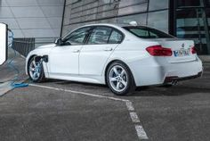 BMW 330e Plug-In Hybrid Manages 25 Miles of All-Electric Range. Combined power output of 252 hp and 310 lb-ft.