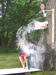 DIY Outdoor Games ~ Dunk bucket & other home made outdoor games for kids birthday parties, events & celebrations. Fun summer crafts & games kids will have fun playing. Great carnival, circus or pool party theme ideas for entertaining.