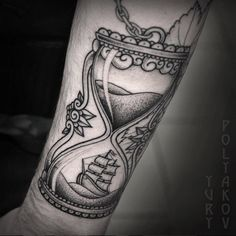 Nautical hourglass tattoo by Yury Polyakov