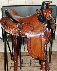 black bucking rolls, saddle strings, dally wrap, and even covered cantle on a chesnut saddle NEAT!