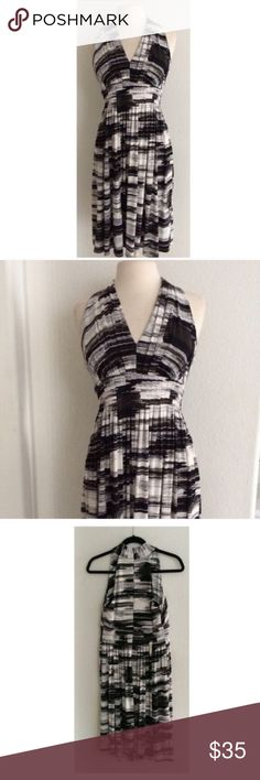"""Calvin Klein halter dress Calvin Klein black and white dress. This is an absolutely stunning dress in almost brand new condition. 42"""" long. Zipper closure in the back. The front/ cups are very slightly molded. This dress has a little bit of stretch and the bottom half is extremely flowy. 95% polyester/5% spandex.                                                                               🚫NO TRADES🚫 💲Reasonable offers accepted💲 💰Ask about bundle discounts💰 Calvin Klein Dresses Midi"""