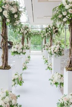 wedding altar decoration aisle decorated with tall trees and white roses bridal arch astin hwang via Wedding Altar Decorations, Wedding Ceremony Ideas, Wedding Altars, Wedding Scene, Wedding Centerpieces, Wedding Events, Wedding Flowers, Church Wedding, Wedding Bride