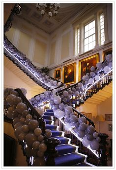 An eclectic, whimsical London wedding- Hundreds of grey balloons bundled together with an underlying neon lighting equals major WOW factor!