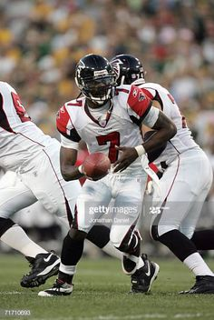 Quarterback Michael Vick of the Atlanta Falcons drops back to handoff during the preseason game against the Green Bay Packers on August 19 2006 at. Michael Vick, August 19, Atlanta Falcons, Green Bay Packers, Football Helmets, Wisconsin, Nba, Game, Sports