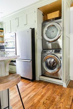 Concealed stackable washer and dryer in a vintage craftsman kitchen