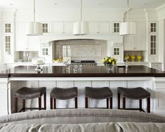 White Kitchen with White Island and dark counter