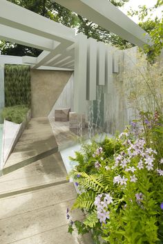 Another pic of my best in category garden at RHS Hampton court palace in 2014 'garden of solitude' still my favourite garden I've designer to date... The geometric pergola come waterfall was a work of art (if I do say so myself!) www.alexandrafoggatt.com gold award winning garden designer, plantswoman and living wall expert