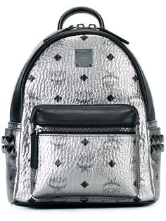 MCM logo print backpack.  mcm  bags  leather  backpacks   Metallic Backpacks 944add32bbd73