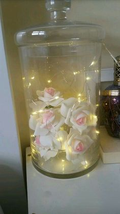 Candy jar. Added led lights and flowers.