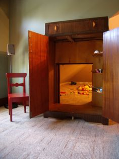 turn a storage closet into a hidden playroom by putting a faux dresser in front - so fun!