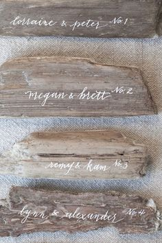 Elegant calligraphy on simple planks of driftwood makes for simple but sophisticated escort cards.