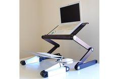 Uncaged Ergonomics WorkEZ Executive Standing Desk | Macworld review  http://www.macworld.com/article/1167066/executive_standing_desk_turns_any_desk_into_a_standing_desk.html