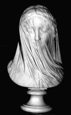 """The Veiled Virgin is a Carrara marble statue carved in Rome by Italian sculptor Giovanni Strazza, depicting the bust of a veiled Blessed Virgin Mary.recorded on December 4 in the diary of Bishop John Thomas Mullock:  """"Received safely from Rome, a beautiful statue of the Blessed Virgin Mary in marble, by Strazza. The face is veiled, and the figure and features are all seen. It is a perfect gem of art."""""""