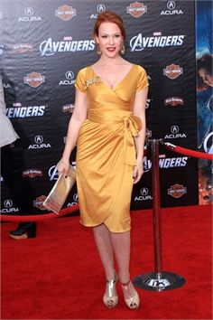 Actress Erin Cummings attends the Avengers Premiere in the Gold Ava by Pinup Couture