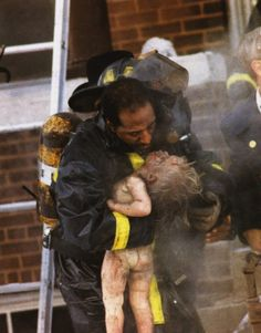 Strong photo. Pulitzer Prize for Spot News Photography 1989: Ron Olshwanger, free-lance photographer - For a picture published in the St. Louis Post-Dispatch of a firefighter giving mouth-to-mouth resuscitation to a child pulled from a burning building.