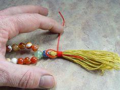 adding tassel to mala beads