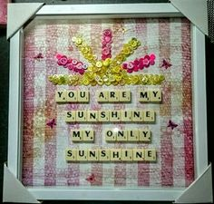 Scrabble tiles and button craft. You are my sunshine.