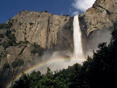 Photograph by David Alan Harvey    A shimmering afternoon rainbow frequently fences Bridalveil Fall in Yosemite National Park. The picturesque, 620-foot (190-meter) waterfall is one of many attractions at the California park, which draws more than 3.5 million visitors each year.