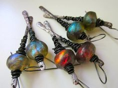 Up Jumped the Devil - primitive cosmic elemental red ultraviolet blue green lampwork glass Basha bead & hammered dark copper stick earring by LoveRoot on Etsy https://www.etsy.com/listing/191329767/up-jumped-the-devil-primitive-cosmic